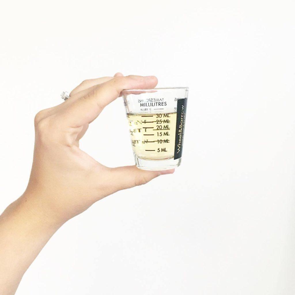 Apple cider vinegar in measuring cup
