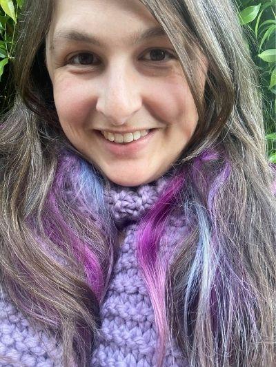 Woman wearing purple scarf